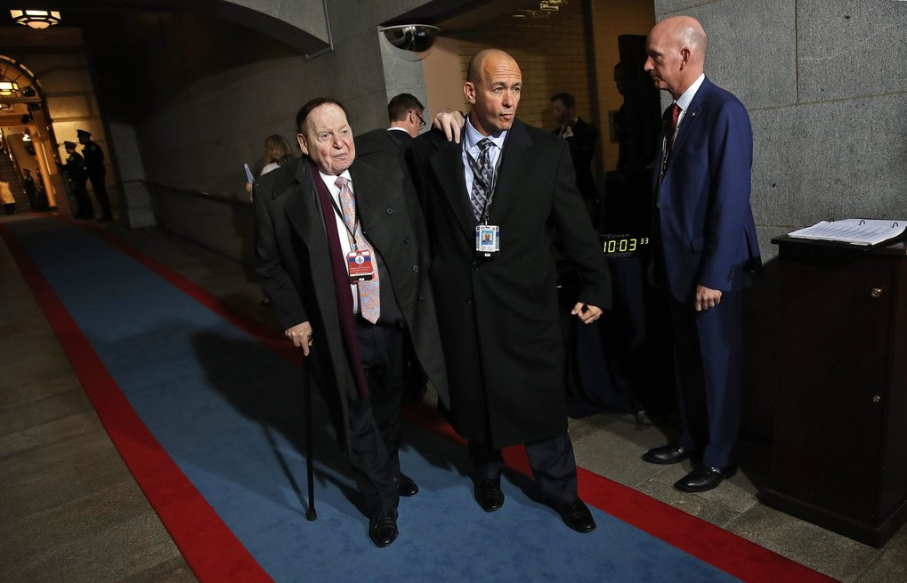 Sheldon Adelson, left, arrives for the presidential inauguration on the West Front of the U.S. Capitol. (EPA/WIN MCNAMEE)