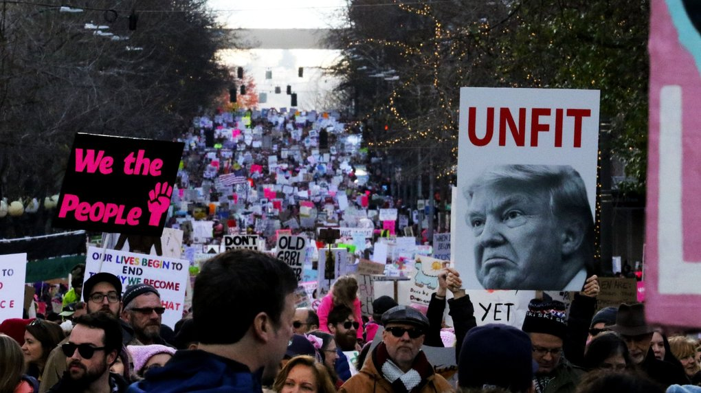 As far as the eye could see, the Womxn's March in Seattle filled Fourth Avenue as it headed to Seattle Center on Saturday.  (Alan Berner / The Seattle Times)