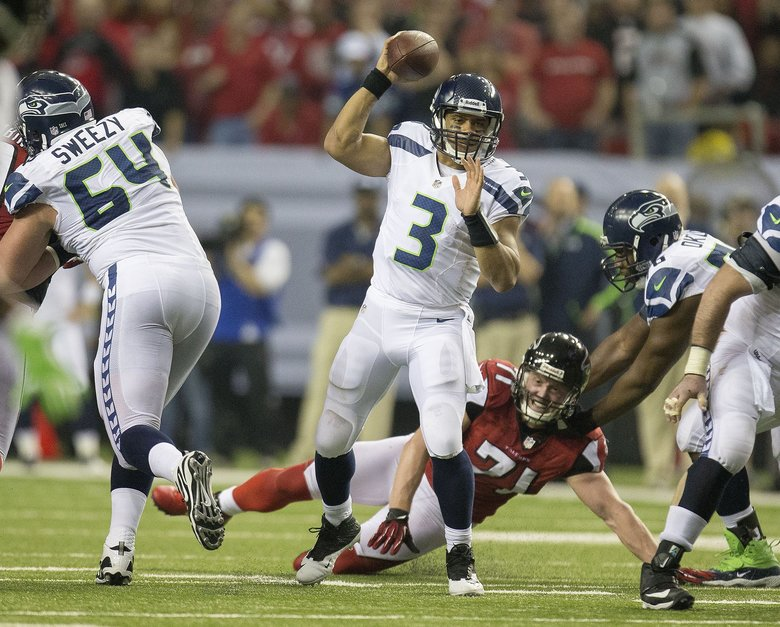 Seattle's Russell Wilson passed for 385 yards against the Falcons in their Jan. 2013 playoff game. (DEAN RUTZ/The Seattle Times)