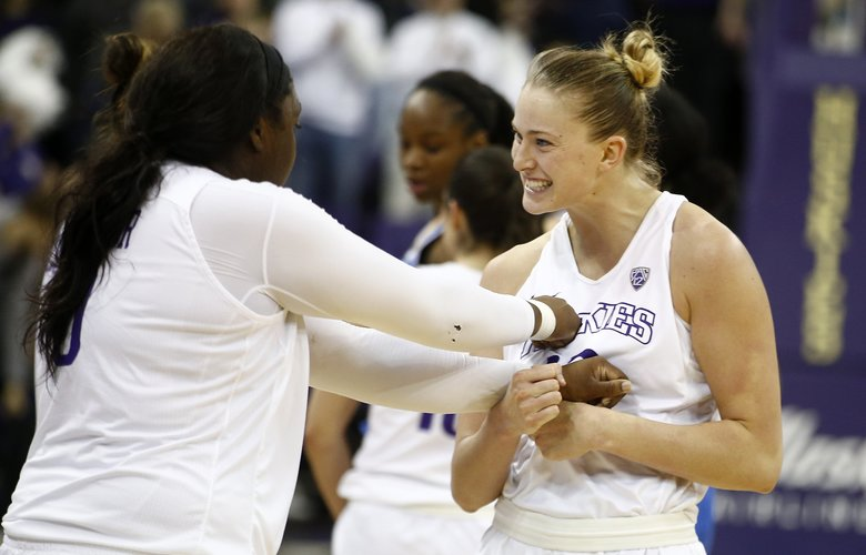 Washington Huskies forward/center Katie Collier (13) celebrates with teammate Chantel Osahor (0) after defeating the UCLA Bruins in an important PAC-12 matchup on Sunday, January 8, 2017, at the Hec Edmundson Pavilion.