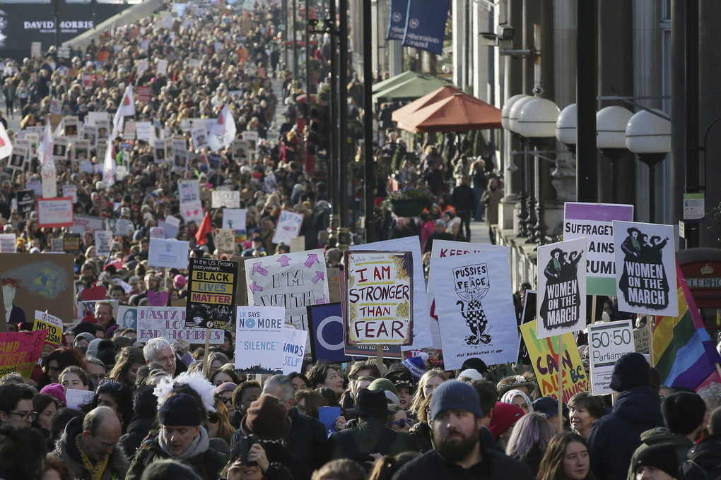 Demonstrators take part in the Women's March on London, following the Inauguration of U.S. President Donald Trump, in London, Saturday Jan. 21, 2016. (AP Photo/Tim Ireland)