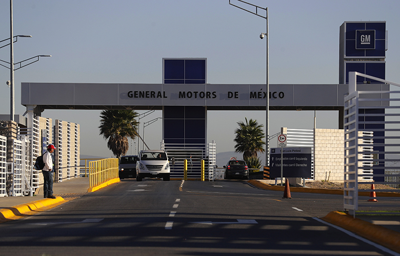Cars exit the General Motors assembly plant in Villa de Reyes, outside San Luis Potosi, Mexico, Wednesday, Jan. (AP Photo/Rebecca Blackwell)