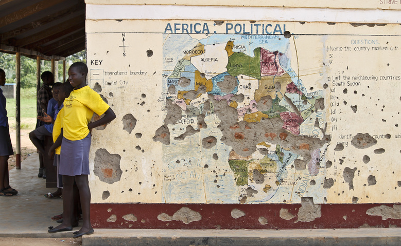FILE – In this Nov. 15, 2016 file photo, students line up outside a classroom with a map of Africa on its wall, in Yei, in southern South Sudan. The Obama administration is set to ease sanctions against Sudan and broaden now limited talks with the long estranged African government, a U.S.-designated terrorism sponsor whose leader has been indicted on war crimes charges, The Associated Press learned Thursday, Jan. 12, 2017. (AP Photo/Justin Lynch, File)