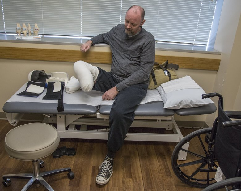 Tim Kuncl still feels phantom foot pain long after his leg was amputated. He's waiting for a checkup with his doctor. The former Coast Guard officer's lower right leg was amputated after doctors at the Veterans Affairs hospital in Seattle allegedly botched treatment of his broken leg.  (Steve Ringman/The Seattle Times)