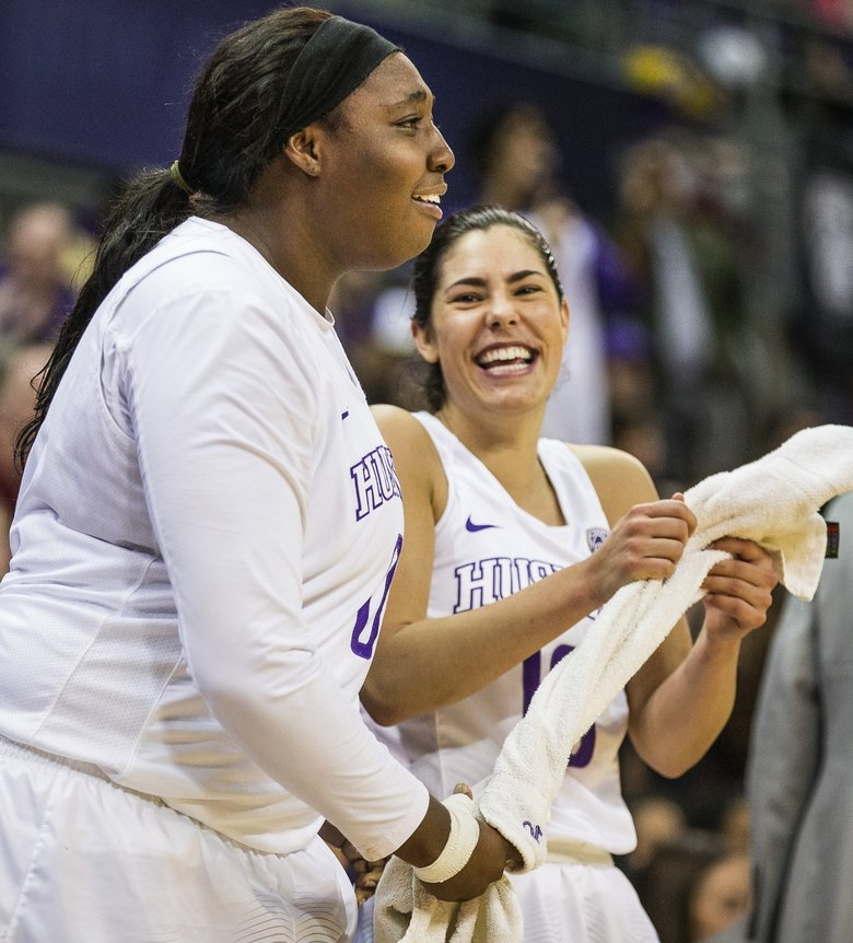 Chantel Osahor and Kelsey Plum come out of the game early in the 4th quarter, and enjoy their teammates play on the court. The Huskies beat WSU 94-63. Washington State University's women's basketball team played the University of Washington in the Pac-12 opener for both teams Tuesday, December 27, 2016 at Alaska Airlines Arena in Seattle. (Dean Rutz/The Seattle Times)