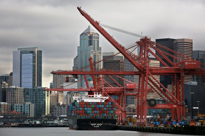 Cranes work on a Hanjin vessel at Terminal 46 at the Port of Seattle in 2015. The bankrupt carrier has a deal to sell its lease on the terminal.  (Erika Schultz/The Seattle Times)