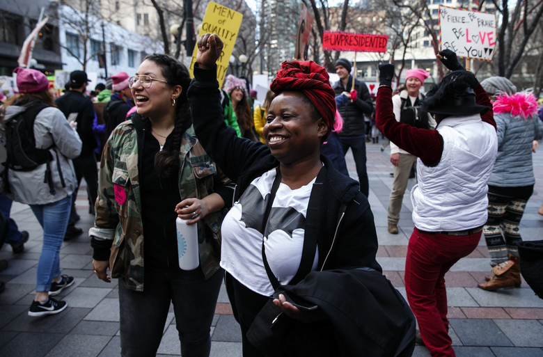 Participants in the Womxn's March on Seattle congregate downtown on Fourth Avenue on Saturday.  (Erika Schultz/The Seattle Times)