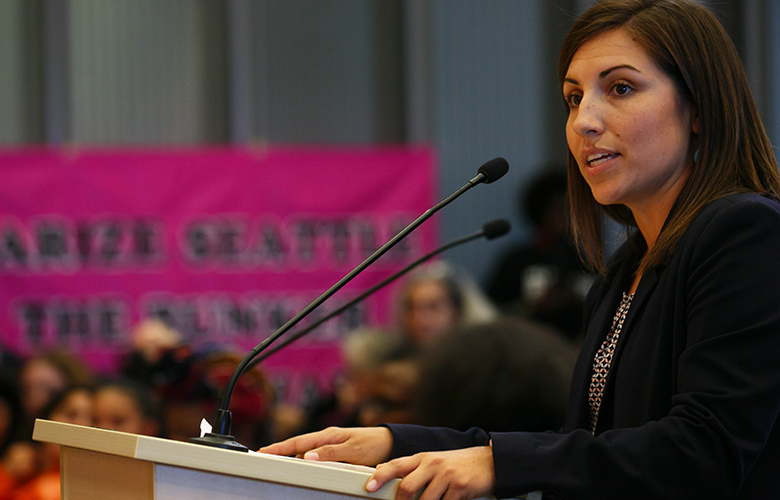 Teresa Mosqueda, with Washington State Labor Council, AFL-CIO, speaks during public comment before the Seattle City Council unanimously approved 'secure scheduling' law for workers in Seattle Monday, Sept.