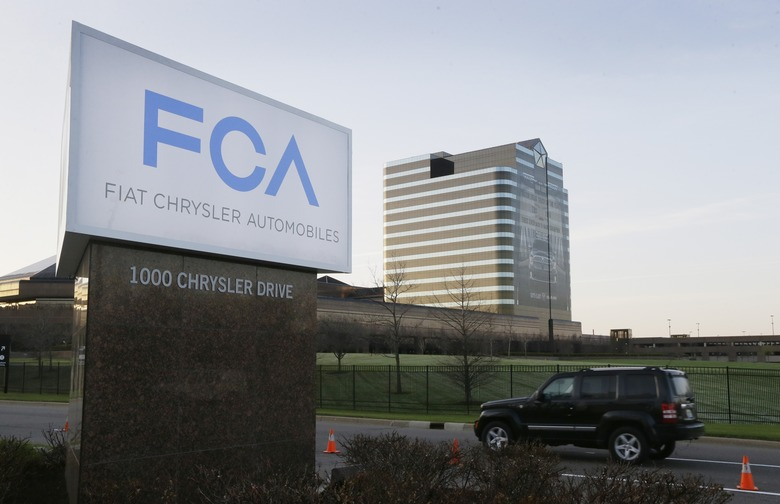 "FILE – In this Tuesday, May 6, 2014, file photo, a vehicle moves past a sign outside Fiat Chrysler Automobiles world headquarters in Auburn Hills, Mich. On Thursday, Jan. 12, 2017, the U.S. government alleged that Fiat Chrysler Automobiles failed to disclose that software in some of its pickups and SUVs with diesel engines allows them to emit more pollution than allowed under the Clean Air Act. The Environmental Protection Agency said in a statement that it issued a ""notice of violation"" to the company that covers about 104,000 vehicles, including the 2014 through 2016 Jeep Grand Cherokee and Dodge Ram pickups, all with 3-liter diesel engines. (AP Photo/Carlos Osorio, File)"