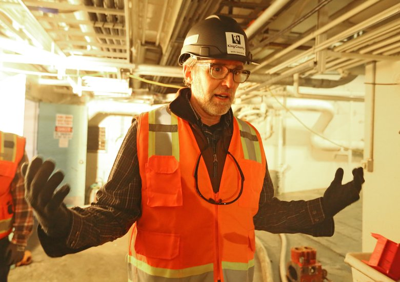 "Mark Isaacson with King County West Point Treatment Plant said ""This is a major catastrophe"" He's in the basement of the West Point Treatment Plant that was totally submerged in 12-feet of water. (Greg Gilbert/The Seattle Times)"