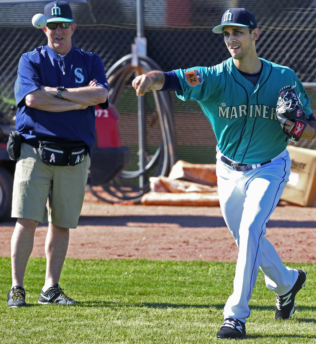 Mariners reliever Steve Cishek pitched for the first time at Mariners spring training, Tuesday, Feb. 21, 2017, in Peoria, Ariz. He threw a total of 25 with trainer Rick Griffin, at left. (Ken Lambert/The Seattle Times)