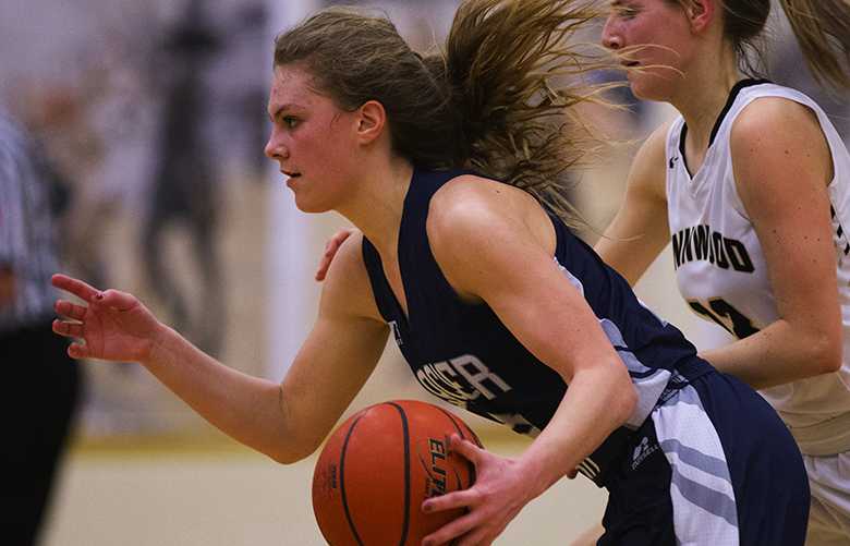 Glacier Peak guard Paisley Johnson drives against Lynnwood guard Taylor Fahey in the first half during Senior Night at Lynnwood High School in Bothell on Friday, Feb. 5, 2016. Lynnwood beat Glacier Peak handily, 79-49.