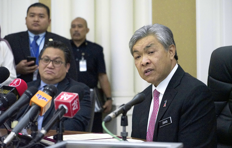 Malaysian Deputy Home Minister Zahid Hamidi, right, speaks to media during a press conference in Putrajaya, Malaysia, Thursday, Feb. 16, 2017. Two women holding foreign passports have been arrested in the killing of the North Korean leader's estranged half brother who was reportedly poisoned by a pair of female assassins who assaulted him as he waited for a flight this week in Malaysia, police said Thursday. (AP Photo/King Chai)