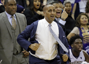 Washington coach Lorenzo Romar pulls on his jacket as a call goes in favor of Arizona late in the second half of an NCAA college basketball game Saturday, Feb. (AP Photo/Elaine Thompson) (Elaine Thompson/AP)