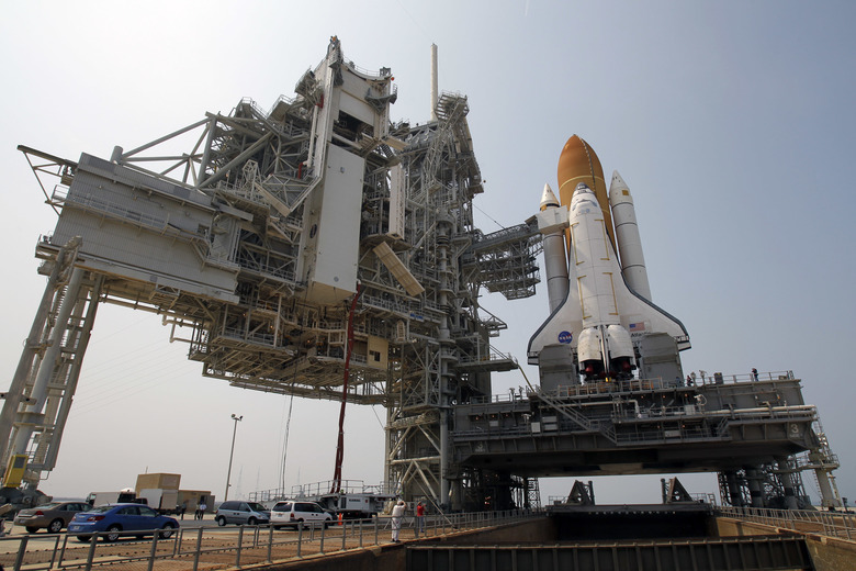 FILE – In this Friday, June 17, 2011 file photo, space shuttle Atlantis is mounted on Pad 39A at the Kennedy Space Center in Cape Canaveral, Fla. Dormant for nearly six years, Launch Complex 39A at NASA's Kennedy Space Center should see its first commercial flight on Feb. 18, 2017. A SpaceX Falcon 9 rocket will use the pad to hoist supplies for the International Space Station. (AP Photo/John Raoux)