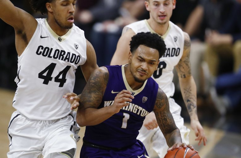 Colorado guard Josh Fortune, left, bumps Washington guard David Crisp who drives downcourt with the ball in the first half of an NCAA college basketball game Thursday, Feb. 9, 2017, in Boulder, Colo. (AP Photo/David Zalubowski)