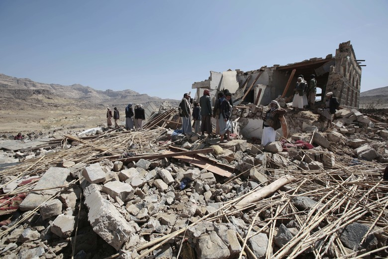 People inspect a house destroyed by a Saudi-led airstrike in the outskirts of Sanaa, Yemen, Thursday, Feb. 16, 2017. At least one Saudi-led airstrike near Yemen's rebel-held capital killed at least five people on Wednesday, the country's Houthi rebels and medical officials said. (AP Photo/Hani Mohammed)