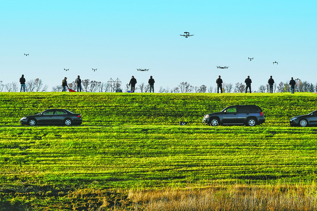 Drone pilots for SkySkopes, a Grand Forks, N.D. company that became the first business in the state legally approved by the Federal Aviation Administration to fly unmanned aircraft for business purposes, gather at a practice airfield.  (Brandi Jewett/SkySkopes Academy via AP)