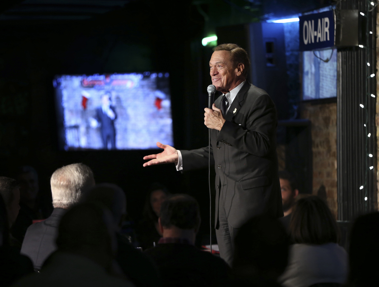FILE – In this Wednesday, Dec. 7, 2016 file photo, actor, comedian and radio host Joe Piscopo addresses a gathering during a comedy event to help raise funds for the Boys and Girls Club of America at the Stress Factory Comedy Club in New Brunswick, N.J. Piscopo is serious when he says he's considering a run for New Jersey governor in 2017. (AP Photo/Mel Evans, File)