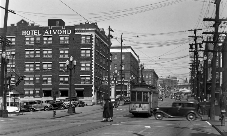 THEN: This 1939 glimpse east from Ninth Avenue follows Pike Street to the end of the three-quarter-mile or so straight climb it makes from Pike Place Market to its first turn on Capitol Hill. (Courtesy Paul Dorpat)