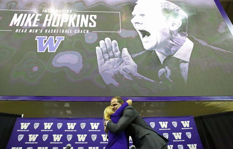 University of Washington Athletic Director Jennifer Cohen hugs Mike Hopkins, the new UW men's basketball coach, at a news conference, Wednesday, March 22, 2017, in Seattle. (Ken Lambert / The Seattle Times)