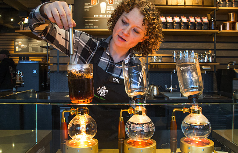 Starbucks Reserve Nicaragua Monimbo coffee is siphon brewed by Bri Sternquist at Starbuck's new Reserve store at First and University in downtown Seattle on Monday afternoon February 27th, 2017.   The process boils hot water into a glass container then siphons the coffee back into a carafe before serving.