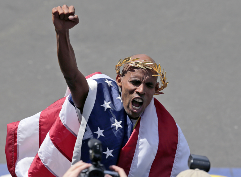 FILE – In this April 21, 2014, file photo, Meb Keflezighi, of San Diego, celebrates his victory in the 118th Boston Marathon in Boston. Keflezighi said he'll hang up his racing shoes for good after running the April 17, 2017, Boston Marathon and the TCS New York City Marathon in November. (AP Photo/Elise Amendola, File)