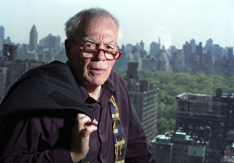 FILE – In this Nov. 2, 2004, file photo, author-columnist Jimmy Breslin poses for a photo in his New York apartment. Breslin, the Pulitzer Prize-winning chronicler of wise guys and underdogs who became the brash embodiment of the old-time, street smart New Yorker, died Sunday, March 19, 2017. His stepdaughter said Breslin died at his Manhattan home of complications from pneumonia. (AP Photo/Jim Cooper, File)