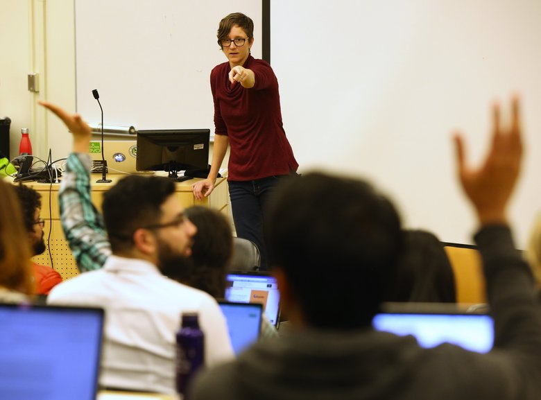 Kate Starbird teaches on Tuesday. Starbird examined the phenomenon of how people peddle bizarre conspiracy theories on social media after mass shootings, and used it to map an emerging alternative media ecosystem on the web of surprising power and reach. (Ken Lambert/The Seattle Times)
