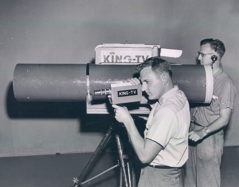 KING cameraman Al Smith, foreground, holds a 5-pound miniature TV camera to be used in the 1958 hydroplane races. It looks pretty small compared to KING'S 100-inch lens, operated by Stan Carlson.  (Art Forde; John Hardin; Dick Cam/The Seattle Times)