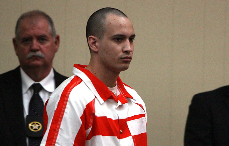 FILE – In this July 20, 2013 file photo, Pvt. Isaac Aguigui of Cashmere, Wash. is lead into a Long County, Ga. (Canadian) $500,000 in insurance and benefit payments. Aguigui of Washington was convicted by a court-martial Thursday March 27, 2014, of murder and causing the death of his unborn child.  (AP Photo/Lewis Levine, File)