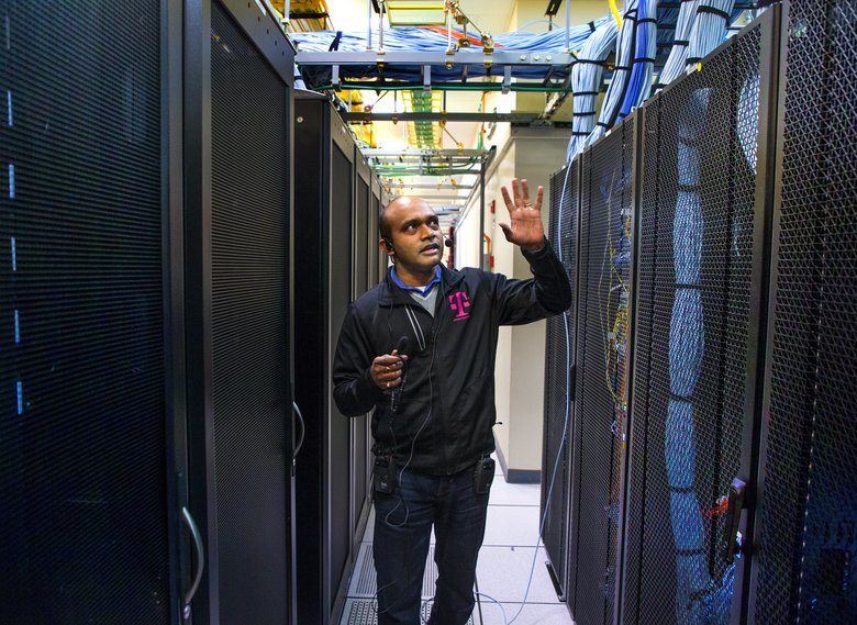 T-Mobile's Srinivasa Chinimilli stands in one of several server rooms at the technology lab — part of T-Mobile's effort to test next-generation wireless technologies and services.  (Mike Siegel/The Seattle Times)