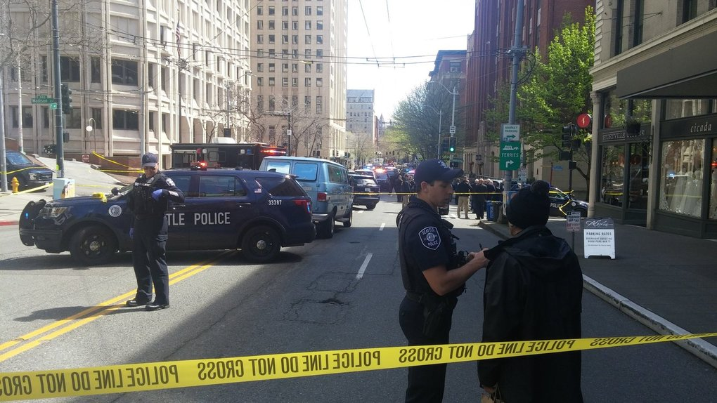 Police officers block off an intersection Thursday afternoon near Western Avenue and Madison Street. (David Gutman / The Seattle Times)