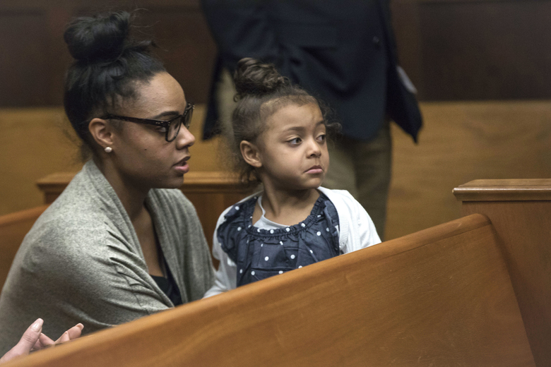 FILE – In this Wednesday, April 12, 2017, file photo, Shayanna Jenkins Hernandez, fiancee of former New England Patriots tight end Aaron Hernandez, sits in the courtroom with the couple's daughter during jury deliberations in Hernandez's double-murder trial at Suffolk Superior Court in Boston. Hernandez was acquitted of those crimes on Friday, but hanged himself in his prison early Wednesday, April 19, 2017, where he was serving a life sentence in the 2013 killing of semi-professional football player Odin Lloyd. (Keith Bedford/The Boston Globe via AP, Pool, File)