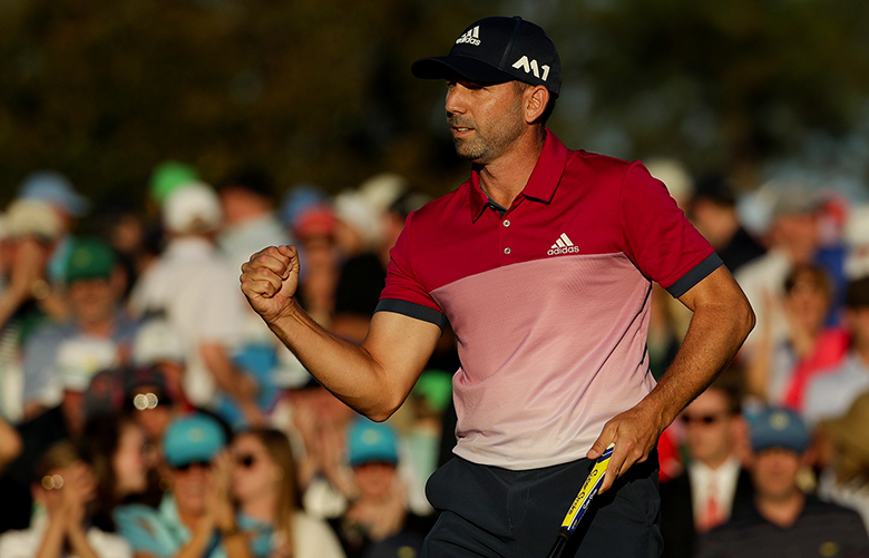 Sergio Garcia, of Spain, reacts after making his putt on the 18th hole during the third round of the Masters golf tournament Saturday, April 8, 2017, in Augusta, Ga. (AP Photo/Matt Slocum) AUG266 AUG266