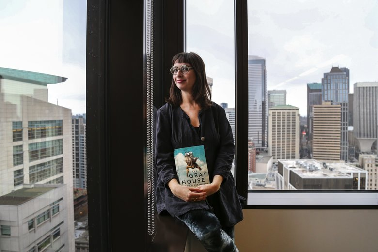 "Gabriella Page-Fort, the editorial director for AmazonCrossing, holds ""The Gray House"" by Mariam Petrosyan. AmazonCrossing is the biggest U.S.  translator of  foreign fiction into English.  (Johnny Andrews/The Seattle Times)"