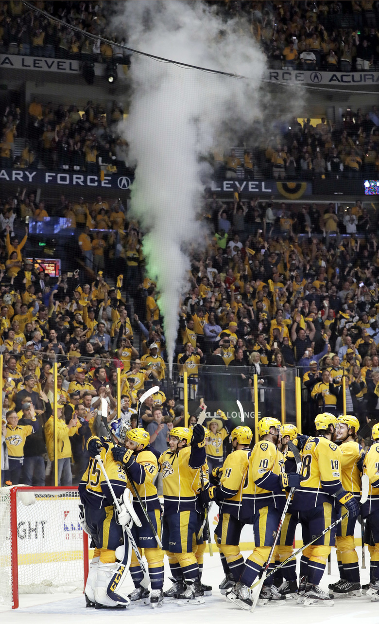 Nashville Predators celebrate after defeating the Chicago Blackhawks 4-1 in Game 4 to sweep the first-round NHL hockey playoff series Thursday, April 20, 2017, in Nashville, Tenn. (AP Photo/Mark Humphrey)