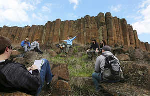 Below the 50-foot basalt columns of the Elephant Mountain lava flow, Nick Zentner, professor at Central Washington University, leads, his Geology 351 class in the field.