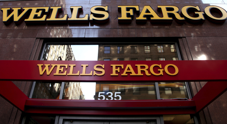 Wells Fargo sign is displayed at a branch in New York. In the results of an investigation released Monday