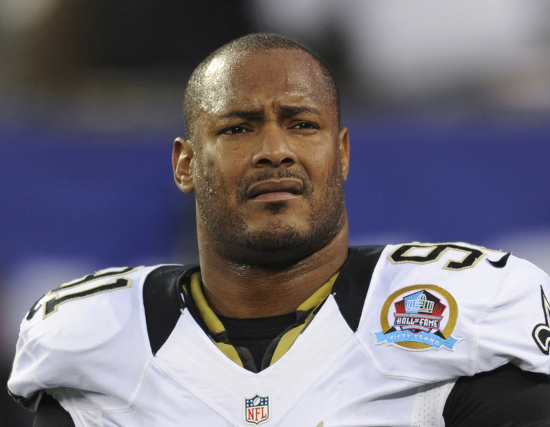FILE – In this Dec. 9, 2012, file photo, New Orleans Saints defensive end Will Smith appears before an NFL football game against the New York Giants in East Rutherford, N.J. Cardell Hayes, the man who killed Smith in an argument following a traffic crash avoided a mandatory life sentence when a jury convicted him of manslaughter instead of second-degree murder. But Hayes may still be locked away for a very long time if prosecutors get their way at a sentencing hearing Wednesday, April 19, 2017. (AP Photo/Bill Kostroun, File)