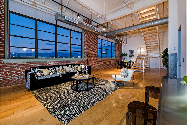 Located in the Biscuit Co. Lofts building in downtown Los Angeles, the unit retains the industrial vibe of the onetime 1920s factory. (Unlimited Style Real Estate via TNS)