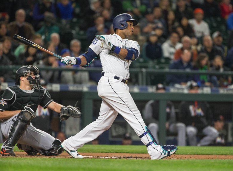 Robinson Cano launches a two-run homer off Miami starter Tom Koehler in the 1st inning. (Dean Rutz/The Seattle Times)