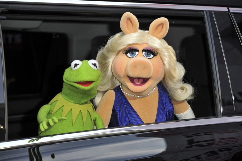 """FILE- In this March 11, 2014, file photo, Kermit the Frog, left, and Miss Piggy arrive at the World Premiere of """"Muppets Most Wanted,"""" in Los Angeles. A New York City museum is asking fans of Jim Henson's Muppets to help pay for an exhibition featuring original puppets of beloved characters like Elmo, Miss Piggy and Kermit the Frog. The Museum of the Moving Image launched a Kickstarter campaign Tuesday, April 11, 2017, seeking $40,000 to help preserve the puppets for posterity. (Photo by Richard Shotwell/Invision/AP, File)"""