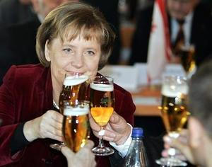 German chancellor Angela Merkel toasts party members today in the eastern town of Demmin  during the Ash Wednesday party meeting. At the meetings, Germany's political parties traditionally criticize one another's policies.
