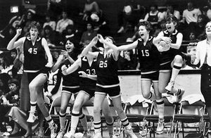 Everett girls players jump for joy after beating Rogers of Puyallup in the Class AAA semifinals at Seattle Center Arena. Girls teams got a state-sanctioned state tournament beginning in 1974.