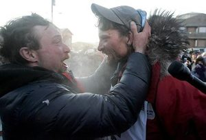 **  CORRECTS ID OF BROTHER TO IDITAROD VETERAN JASON MACKEY **  Lance Mackey, of Fairbanks, Alaska, right, greets his brother Iditarod veteran Jason Mackey, left after winning  the Iditarod Trail Sled Dog Race in Nome, Alaska Tuesday, March, 13 2007, to become the first musher to win both the Iditarod and the Yukon Quest International Sled Dog Race in the same year.  (AP Photo/Al Grillo)    AKAG109