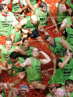 Revelers throw tomatoes at each other during the annual food fight, the Tomatina, in the small Spanish town of Bunol, Spain, Wednesday Aug. 29, 2007.
