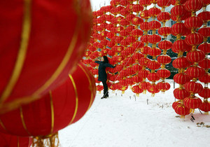 A woman poses for pictures among red lanterns installed for the lunar new year at a square in Wuhan of Hubei Province, China.