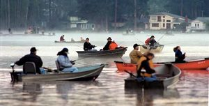 Fishing boats crowd Pine Lake near Issaquah at dawn on the opening day of trout season.