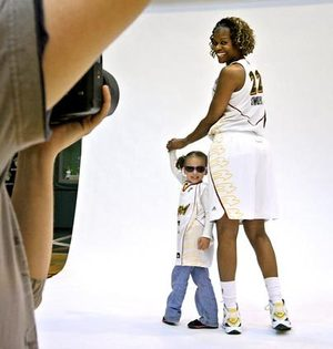 "Storm forward Sheryl Swoopes poses with 4-year-old fan Olivia Henderson at a team media day at the Furtado Center. Swoopes calls the star-powered Storm — including Yolanda Griffith, Sue Bird, Lauren Jackson, Janell Burse and Swin Cash — a ""dream team."""